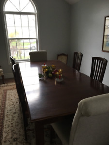 Beautiful Geddes custom made dining room table with ten chairs