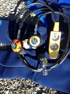 Ladies wet suit and Sherwood regulator and pressure/depth guage