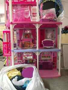Doll house and a lot of dolls and accessories