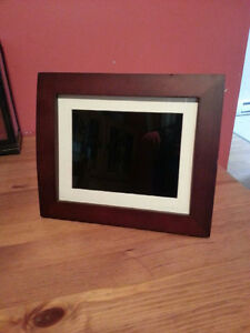 "Sylvania 8"" Digital Photo Frame."