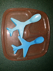Separated plastic plate and airplane spoons