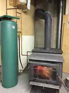 Wood stove with hot water attachment