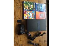 Sony PS2 console plus 4 games chunky black VGC
