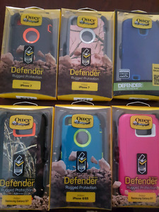 Otterboxing defender cases for iphone and samsung