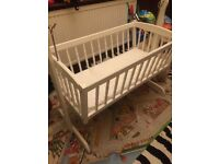 White swinging crib painted in French Chic paint