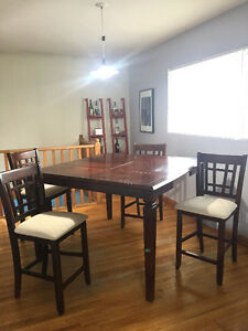 Dining table plus 4 highchairs 250 obo.