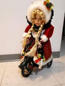 Porcelain Christmas doll on bike