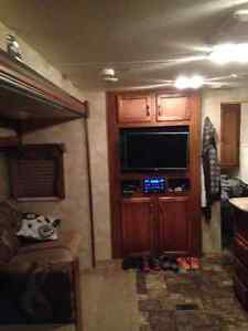 RV set up in park with pool and laundry