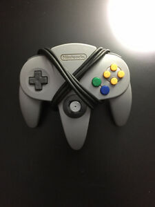 3 Nintendo 64 controllers