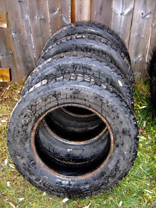 A MATCHING SET OF FOUR SNOW TIRES