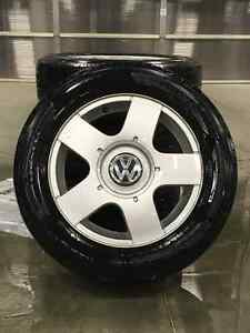 4 Volkswagen Factory Rims and Tires (01 Jetta) Size 195/65/R15.