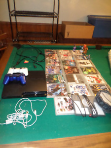 PS3 complete system with 19 games 2 controllers