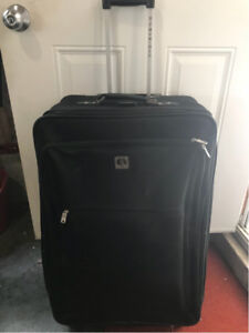 Large Black Suitcase on wheels/ with handle