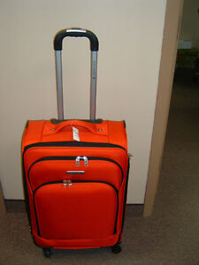 """Air Canada 24"""" Red Luggage"""