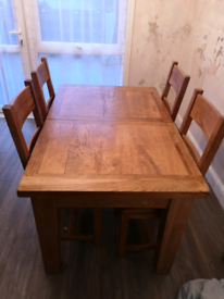 Solid Oak Extendable Wooden Table and 4 Chairs.