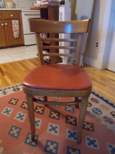 Lovely wooden chairs with red seat