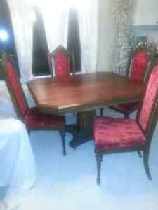 Dining table Antique on caster wheels! with 4 chairs