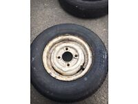 Trailer wheel and new tyre