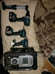 Makita impact drill set with a light and Chainsaw