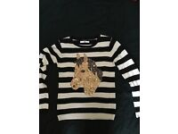 Girls Black and white striped horse jumper age 10-11 yrs from M&S