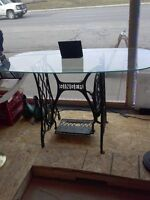 Glass top singer base table