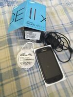 Samsung smart phone new with charger and earphone