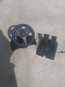 Steering wheel and pedals.