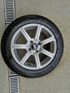 4 Michelin Ice snow tires on alloy wheels