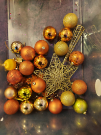 Assortment of gold christmas baubles