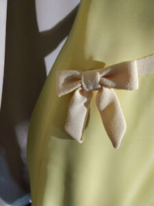 60' light yellow dress with bows