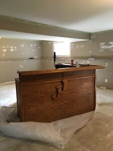 Oak bar with labatt blue tap and keg fridge