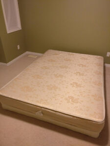 Selling (Used) Queen Size mattress and box.