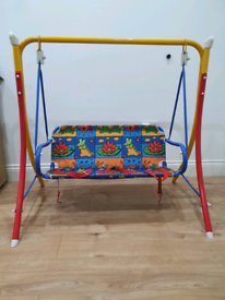 Children's Swing Bench with seat belts.