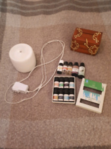 Essential oil diffuser with essential oils $25
