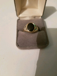10K Gold Ring with 2 diamond accents by the black onyx