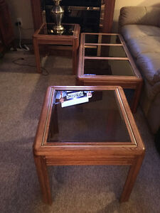 Wooden Coffee and End Tables with Smoked Glass tops..