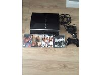 PS3 console with 4 games and controller
