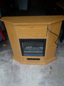 Electric fireplace with drop corner mantle.  $100