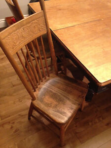 Antique table and press back chairs