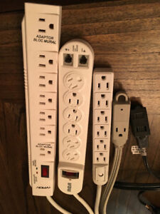 Two surge protectors, one power bar, two extension cords