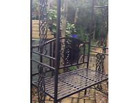 Iron bench with beautiful trellis