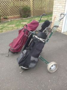 2 sets of golf clubs and golf carts