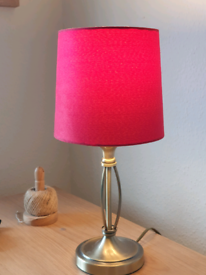 Lamp with red shade.