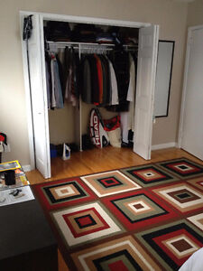 Walk to Queen's! Master Bedroom,Large Closet! Available May 1st.