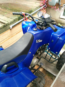 125cc 4 wheeler with reverse and electric start good little bike