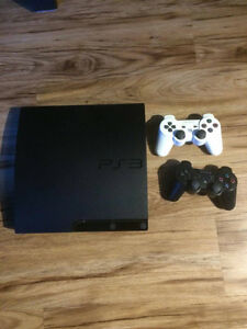 PS3 with 2 controllers and 17 games!!