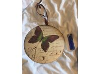 Round shabby chic metal hanging butterfly sign.