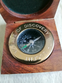 Brass nautical compass set in wood box