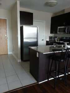 Gorgeous 1 + Den Condo in sought after Green Life building