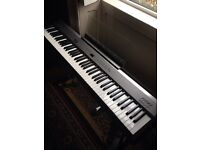 Roland FP2 Digital Stage Piano Can post.